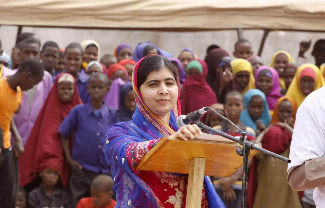 Malala Yousafza, speaks to refugees in the Dadaab refugee camp, Kenya, Tuesday, July 12, 2016. Nobel laureate Malala Yousafzai is spending her 19th birthday in Kenya Tuesday visiting the world's largest refugee camp to draw attention to the global refugee crisis, especially as Dadaab camp faces pressure to close after a quarter-century. (AP Photo/Khalil Senosi)